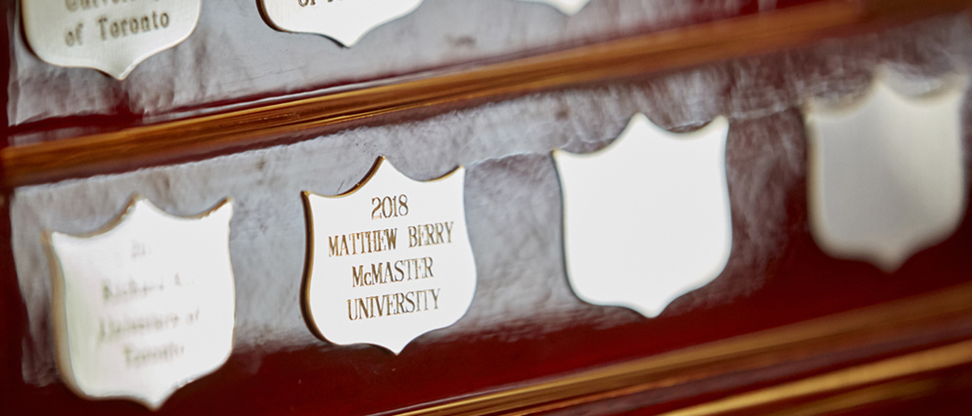 McMaster PhD student Matthew Berry's name is inscribed on a gold plate on the base of the Ontario 3MT trophy