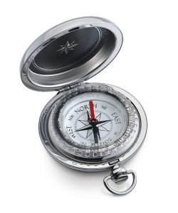 a silver compass, with the arrow pointing north